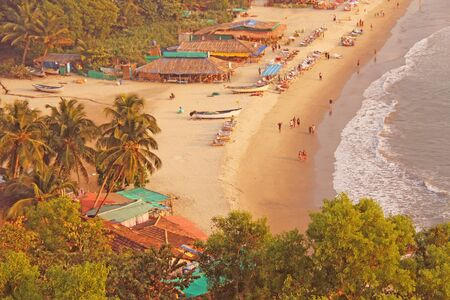 Arambol Beach. View from the sky, from  above, aerophoto, point of view. View of the beach. Long beautiful beach, top view. People walk on the beach, relax on the beach. Toned photo. Zdjęcie Seryjne