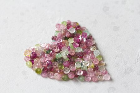 Heart. Beautiful heart made of natural stone tourmaline. Heart on a white background. Greeting card for Valentine's day. Declaration of love. Copy space for your text. Banque d'images - 129251695