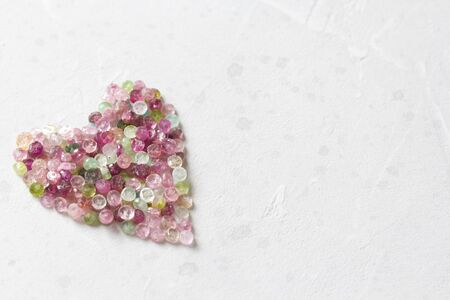 Heart. Beautiful heart made of natural stone tourmaline. Heart on a white background. Greeting card for Valentine's day. Declaration of love. Copy space for your text. Banque d'images - 129251584