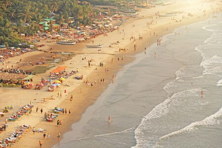 Arambol Beach. View from the sky, from  above, aerophoto, point of view. View of the beach. Long beautiful beach, top view. People walk on the beach, relax on the beach.
