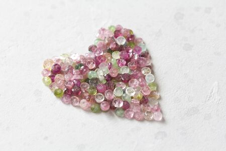 Heart. Beautiful heart made of natural stone tourmaline. Heart on a white background. Greeting card for Valentine's day. Declaration of love. Copy space for your text. Banque d'images - 129251366