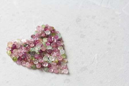 Heart. Beautiful heart made of natural stone tourmaline. Heart on a white background. Greeting card for Valentine's day. Declaration of love. Copy space for your text. Banque d'images - 129251376
