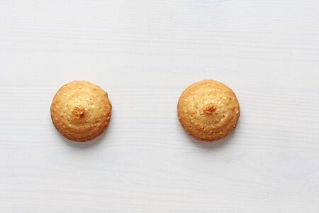 Cookies on a white background, similar to female nipples. Sexy nipples in the form of cookies. Humor, double meaning. Standard-Bild