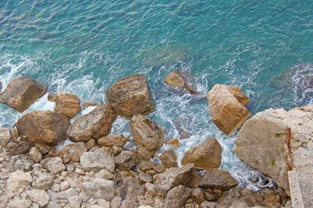 View from Above on the Sea and Stones or Rocks in the City of Taormina. The island of Sicily, Italy. Beautiful and Scenic View of the Sea and Rocks.