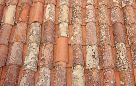 Roof of Tiles. Terracotta Old Tiles. Beige Background from Tiles. Tile roof.