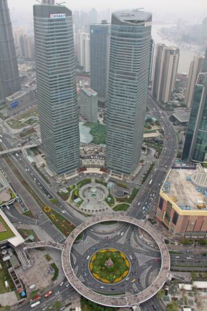 City of Shanghai, top view from the tower of the Pearl of the East on roads and transport interchanges.