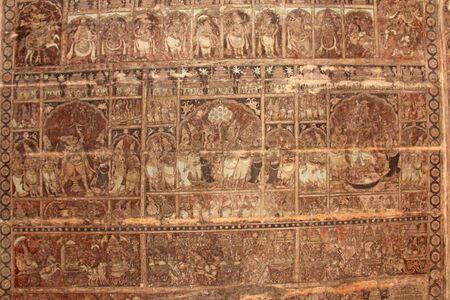 Frescoes and ancient drawings paintings and scenes on the ceiling in Shiva Virupaksha Temple. Ancient terracotta patterns.