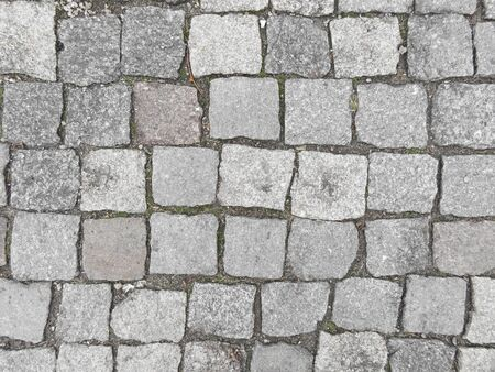 Road from paving stone, texture stones, background of old stones. Old pavement.