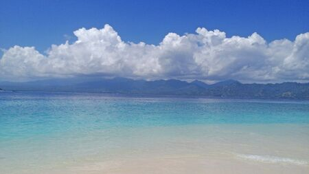 The azure sea, white clouds and white sand. Indonesia, Gili Islands, Gili Meno. Stok Fotoğraf