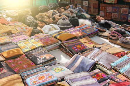 Leather bags over the shoulder are sold in the market of bazaars in India, Goa.