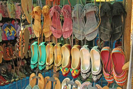 Indian shoes shoes are sold on the market in India. Gift souvenir India Tibet Bazaar. Stock Photo