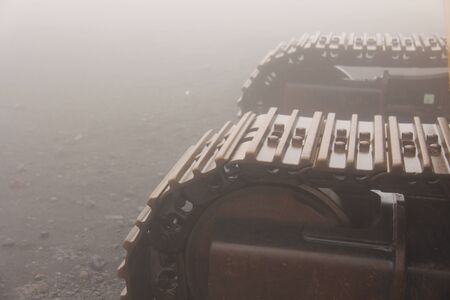 Big Caterpillar Tractors on the Island of Sicily, Italy. Mystical Metal Caterpillars in the Fog on Mount Etna. 写真素材
