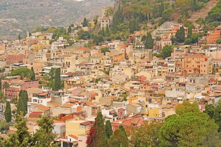 Beautiful Scenic View of Taorminas Old Town. Terracotta Old Ancient City Houses with Tiled Roofs. The island of Sicily, Italy.