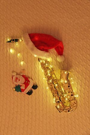 Golden saxophone alto and christmas decoration