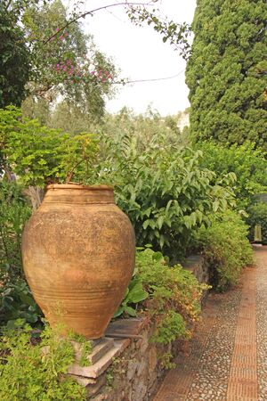 Large Ceramic Terracotta Pot in the Park. Botanical Garden of Taormina. The island of Sicily, Italy. 写真素材