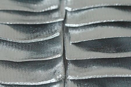 Silver Metallic Bright and Brilliant Background from Fotlga. Beautiful Glamorous Background for Your Design, Cover Design, Postcard. Silver or Gray Background.