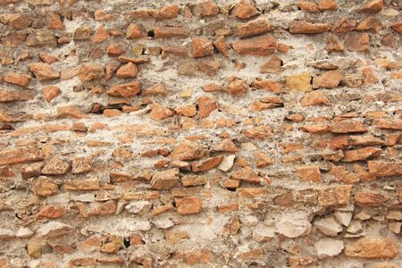Old Wall of Red Bricks and White Brayed and Cracked Old Paint. Red, Terracotta and White Brick Background. Old Wall for Background, Design, Design and Template.