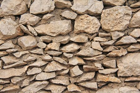 Stone Background. Background from the Great Stones. Beige Blank Background for Your Design, Patterns, Patterns. Stock Photo