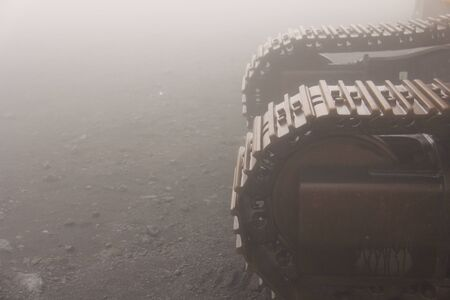 Big Caterpillar Tractors on the Island of Sicily, Italy. Mystical Metal Caterpillars in the Fog on Mount Etna.
