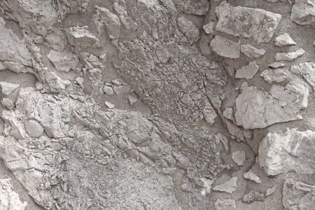 Background Of Gray Rocks. Gray Marble Background. Old Gray Stones. The island of Sicily, Italy. Stock Photo