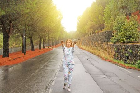Young Girl Smiling and showing Bumps. The Magic Forest at the Foot of Mount Etna. The island of Sicily, Italy.