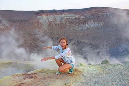 A girl on the Gray Hydrogen Volcano and Volcano Craters on Vulcano Island, Lipari, Italy. Sunset, Gas, Sulfur, Poisonous Pairs, Evaporation. Zdjęcie Seryjne