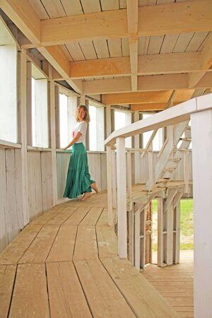 Girl in a long green skirt. Russia. Art Park Nikola Lenivets.