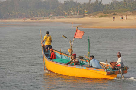 India, GOA, January 19, 2018. Fishermen on boats go to sea. Fishermen in boats are fishing and swimming along the river.
