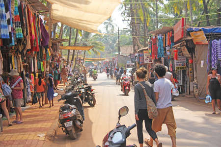 India, Goa, Arambol. January 28, 2018. The central street of Arambol, on which people go on scooters and walk on foot. Publikacyjne