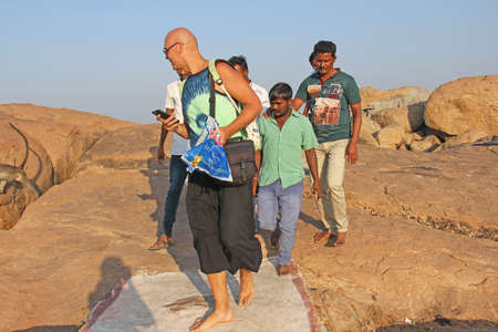 India, Hampi, January 31, 2018. Men of Indians go to the European and want to be photographed with him.