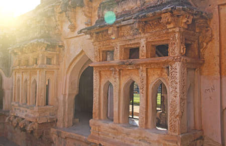 Queen baths in Hampi, Karnataka state, India. Carving stone ancient background.Carved balcony.