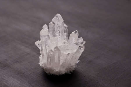 Large crystals of natural transparent stone rock crystal close-up, transparent quartz in crystals, rock, geology, magical rites and esotericism. White transparent stone on a black background.