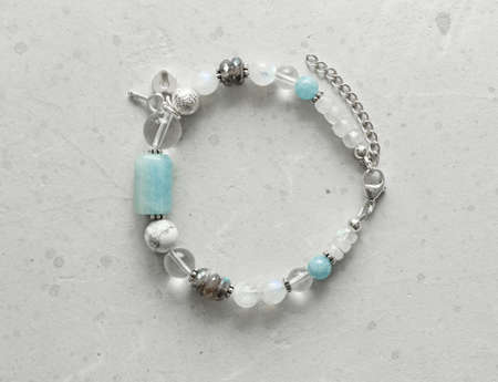 Beautiful asymmetrical designer bracelet made of natural stones and silver. Aquamarine, rock crystal, cacholong, larimar, moonstone. Handmade jewelry made from natural stones.