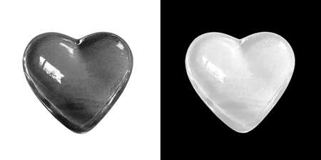 Glowing crystal black heart isolated on white background and white heart isolated on black background with clipping path. Balance of love and life concept.