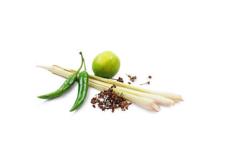 Ingradients of Tom Yum Kung isolated on white background with clipping path. Herbs for making Thai food such as green chili, lime, lemon grass, and spice. Stock Photo