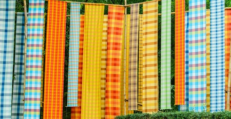 apparel: Colorful loincloth fabric in Thai style background. Stock Photo