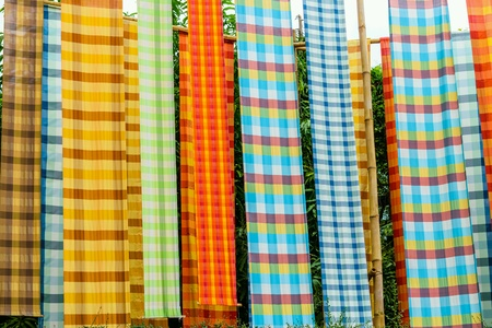 Colorful loincloth fabric in Thai style background. Stock Photo