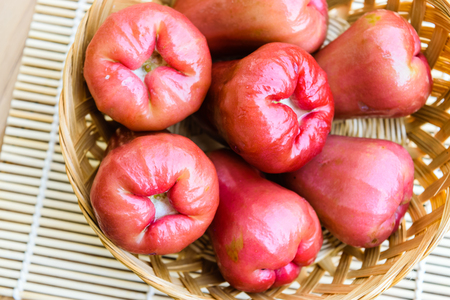 guava fruit: Ripe rose apple fruits on bamboo basket
