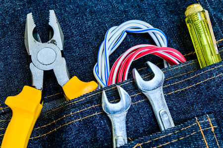 variety of tools in belt bag jeans Stock Photo
