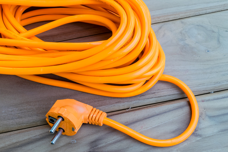 close up color orange electric extension cord Фото со стока - 79129042