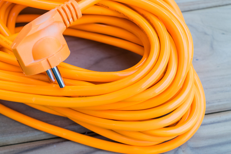 close up color orange electric extension cord