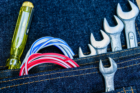 alicate: variety of tools in belt bag jeans Foto de archivo