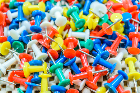 Many colorful push pins on the background Stock Photo