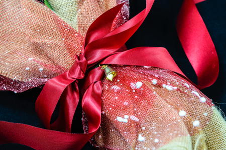 Bouquet flowers with red ribbon wrapped into brown sack cloth Stock Photo