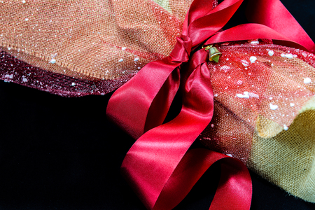 flirtation: Bouquet flowers with red ribbon wrapped into brown sack cloth Stock Photo