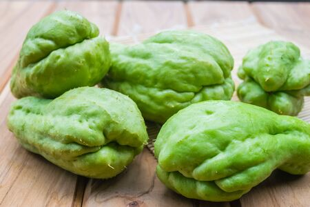Fresh Chayote fruit on wooden table