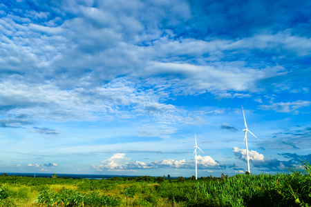 windy energy: Wind turbines generating electricity with blue sky in wind farm from Thailand