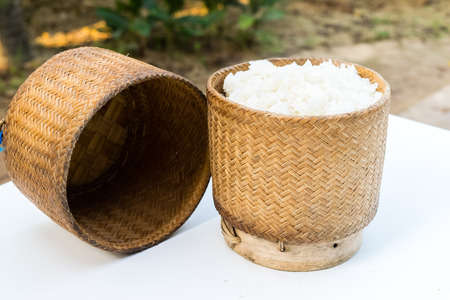 steaming sticky rice on earthen steamer , glutinous rice , northeastern of thailand food