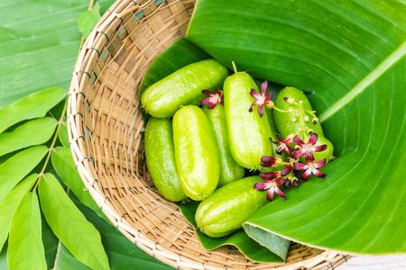 Averrhoa bilimbi fruit with flowers on banana leaf Stock Photo - 98700600