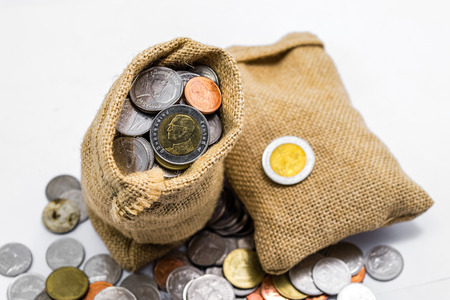 Thai baht money in sack isolated on white background Stockfoto